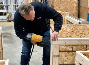 a member of the Bruning International team working on crating